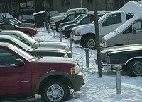#fairbanks-carplugs-5934 - Cars plugged into electrical outlets at Fairbanks, Alaska